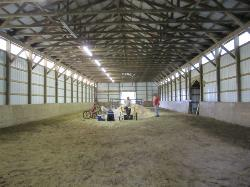 lighted indoor riding arena with soft footing